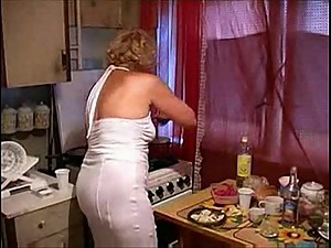 A  mom fucked by her son in the kitchen..