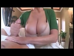 Massive Titted Stepmom Gives Hand Relief..